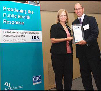 Laboratory Director accepting the APHL Excellence in Public Health Response Award