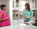 Image of two moms talking in a kitchen