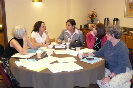 Photo of group discussion (Sharon Newcomb-Kase, Mirsa Douglass, Simran Tiwana, Colleen Buechner, and Margaret Bruch)