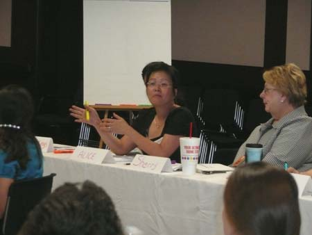 Alice Gong participates in discussion with Sherry Clay listening