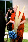 Employees hold over-sized scissors for the ribbon-cutting ceremony at the Laboratory Building Grand Opening in 2003. Photo courtesy of Ivan Dudik.