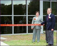 Laboratory managers hold the right side of the ribbon for the ribbon-cutting ceremony during the Grand Opening in 2003. Photo courtesy of Ivan Dudik.
